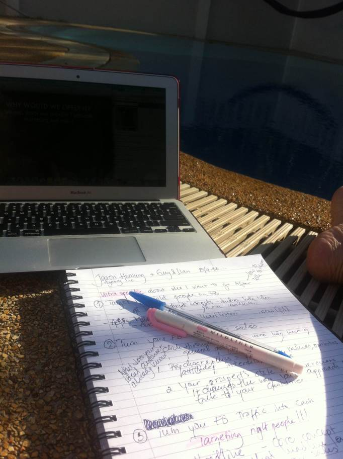Attending a webinar and taking notes by the pool when the sun is rising over the mountains.
